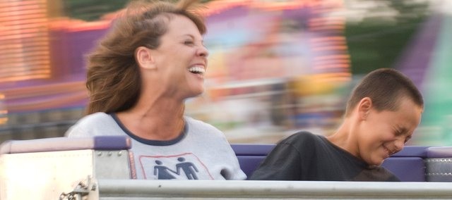 Teresa Nickel and her grandson Isacc Nickel brace themselves as they ride the Scrambler.