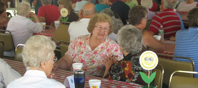 Local residents taking part in Senior Day at the Leavenworth County Fair mingle Friday at the Leavenworth County Fairgrounds. Bingo, musical entertainment, a picnic lunch and a shuttle around the fairgrounds were provided to the senior fairgoers Friday.