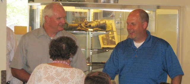 City Administrator Mark Loughry (right) talks with Basehor Police Chief Lloyd Martley and Anna Mary Landauer at the meet and greet in his honor Aug. 13. The meet and greet was arranged at the Basehor VFW Hall to give community members a chance to meet the newest member of the city's staff.