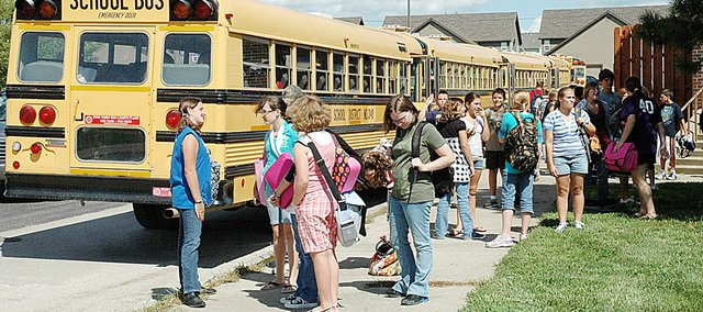 The first full day for everyone in the Baldwin School District was Thursday. Here students at Baldwin Junior High School wait to board the bus after the first day of school. Although the numbers aren't official until Sept. 21, but early indications are enrollment is down this year.