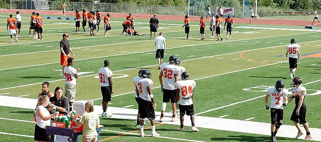 Baker University's football team practices at Liston Stadium Friday afternoon. The Wildcats open their season Sept. 5 at Missouri Valley. Their home opener is Sept. 12 against MidAmerica Nazarene.