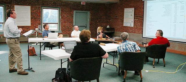 Gabe Henshaw, left, of Manning Construction, talks to the Baldwin Board of Education Monday night. Henshaw presented the bids for the new Baldwin Elementary School Primary Center. The school board approved those unanimously.