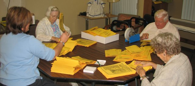From left: Tina Ashford, Bonner Springs Senior Center assistant director, Reba Shaw, Ken Stewart and Edna Stewart assemble the senior center's monthly newsletter. Bonner Springs Senior Center Director Nancy Johnson said senior citizens preferred to use such newsletters to communicate with friends and family.