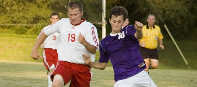 Kenny Schultz battles Baldwin defender Levi Moore for position on Friday at Chieftain Park. Schultz scored Tonganoxie High's only goal in a 1-1 tie.