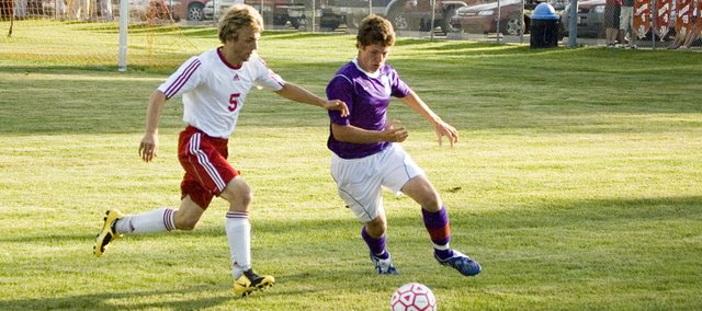 Tonganoxie High defender Jake Willis contends with a Baldwin attacker during the Chieftains' 1-1 tie with the Bulldogs on Friday night at Chieftain Park.