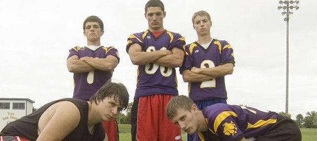 McLouth High's football seniors — Kyle Mabary, Chris Culter, EJ Field, Tyler Drinnon and Dacoda Reusch — are outnumbered by a large group of underclassmen as the team prepares to open its 2009 season.