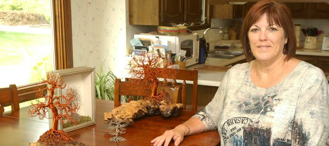 Kathy Horniman will display and sell the trees she makes from copper wire at the De Soto Art Council's Art Walk Saturday. The Art Walk will be part of the De Soto Days Festival and be from 9 a.m. to 4 p.m. Saturday at Riverfest Park.