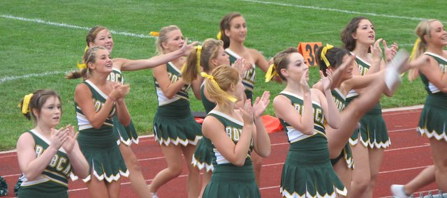 The Basehor-Linwood High School cheerleaders perform for a crowd Aug. 27 during the Meet the Bobcats event. The squad's seniors said they had plans for new, more difficult stunts this year.