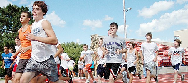 Members of the Baldwin High School boys' cross country team begin a timed run at the Liston Stadium track earlier this season. The Bulldogs are ranked No. 2 in the state to begin the 2009 season. They will compete at the Anderson County Invitational today.