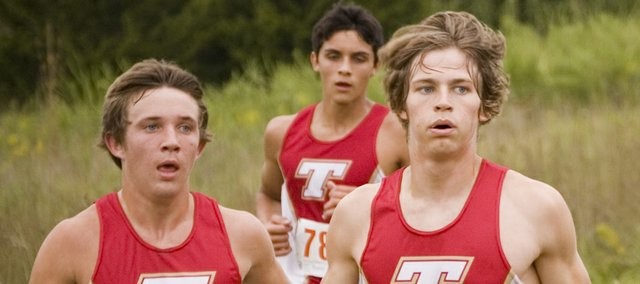 Tonganoxie High cross country runners Justin Soetaert, Dalton Harrington and Keith Slater pace each other as they compete in the team's season-opening dual with Lansing on Thursday. The Chieftains beat the Lions by scoring 20 points — 23 fewer than LHS.