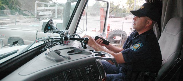 Lt. Chris Turner demonstrates how the radar works inside of a decoy truck used for the Trucks on Patrol for Safety program this year.