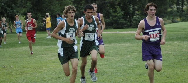 Austin Hinchey (70) and Angel Vasquez (86) run during De Soto's first cross country meet of the year Thursday at Anderson County. Hinchey finished the race in third and Vasquez finished fifth. The De Soto boys took first and the girls finished second overall.