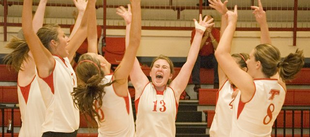 Chieftains Molly O'Hagan, Abby Eisman, Ali George, Shyanne Gergick and Danielle Miller celebrate an ace during Tonganoxie High's five-game victory over Baldwin on Wednesday night at THS.
