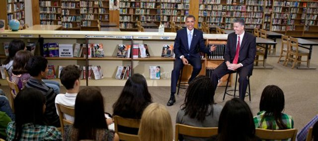 President Barack Obama and Education Secretary Arne Duncan participate in a discussion wi