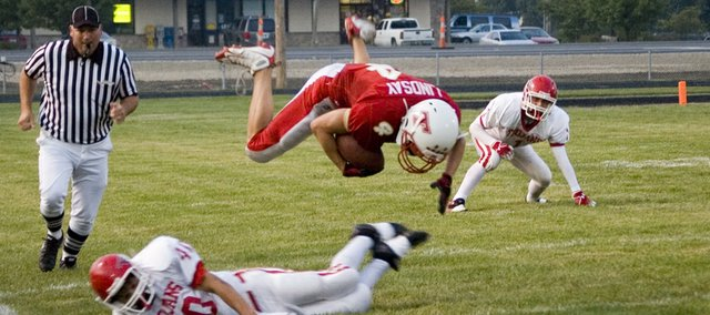 DJ Lindsay is upended near the sideline by an Osawatomie defender during the first half on Tonganoxie High's 36-33 homecoming loss on Friday night at Beatty Field. It was one of the rare times OHS stopped Lindsay, however, as the senior finished with 187 rushing yards, 43 receiving yards and two touchdowns.