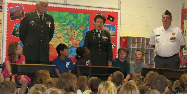 Mary Rose Enderle (middle) tells fifth-graders at Basehor Elementary School about her experience in the military.