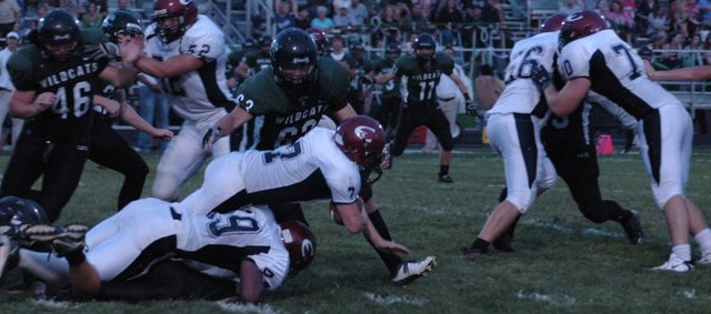 Evan Cleveland dives forward for a first down Friday night at De Soto. Cleveland had 136 yards rushing and one touchdown and also picked off a pass in Eudora's 27-6 win over De Soto.