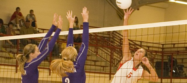 Molly O'Hagan gets her fingertips on the ball up above the net for Tonganoxie as the Chieftains defeated Baldwin in their season opener.