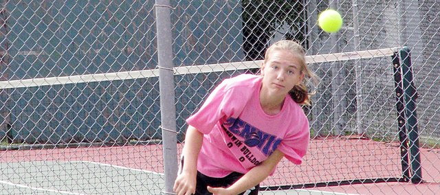Baldwin High School freshman Kaitlin Jorgensen returns a ball over the net Saturday at Marysville. Jorgensen finished third at No. 2 singles for the Bulldogs.