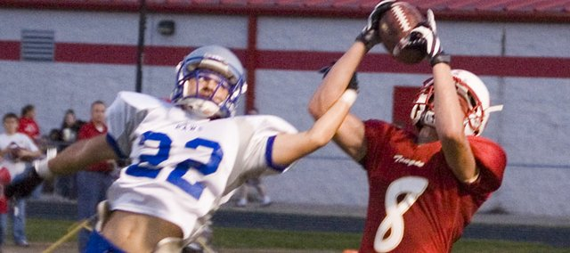 Justin Jacobs hauls in a 38-yard pass for Tonganoxie High on the first play of the second quarter during the Chieftains' 14-0 victory over Perry-Lecompton on Friday night at Beatty Field.