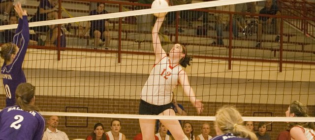 Maggie Franiuk goes up for a kill in this Mirror file photo. After Tonganoxie High went 1-3 at the Rossville Invitational this past weekend, the team hopes to turn things around on Saturday at the Tonganoxie Invitational, which starts at 8 a.m.