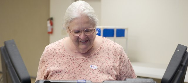 Pat Montgomery casts her vote this morning at the Tonganoxie VFW for today's special election.