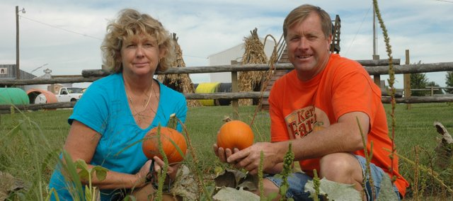 Terri and Jim Kerby, owners of Kerby Farm, prepare their pumpkin patch to open Friday, Sept. 25. Kerby Farm, located three miles west of Bonner Springs, offers many family-friendly, fall-related activities in addition to the pumpkin patch.