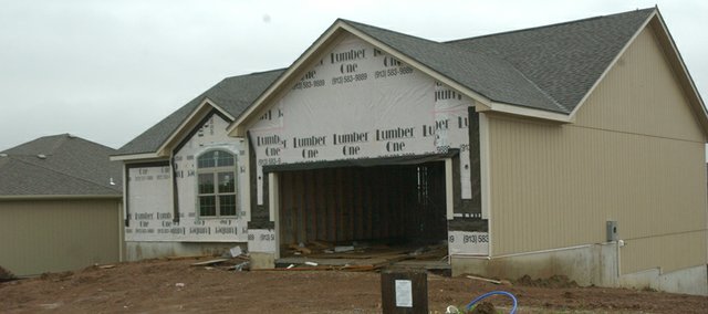 New home construction, such as this house being built in the Arbor Ridge Subdivision, has been a rare sight in De Soto this year. The city has issued just four new single family home permits this year.