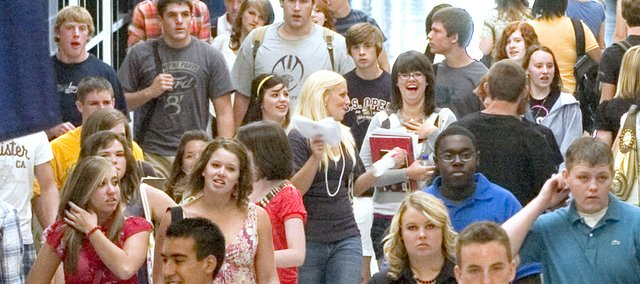 Students cram the hallways of Mill Valley High School in this 2008 file photo. Officials with De Soto USD 232 and Shawnee Mission USD 512 report enrollment is up in both districts this school year but state budget cuts are forcing some difficult decisions.