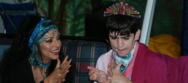 Zaina Ali (left) claps along with Melissa Bottiger recently during a music session at Dreams Work Inc. Ali, a belly dancer, visits and performs with music therapist Maggie Rodgers every Wednesday at Dreams Work, a day care for developmentally disabled adults.