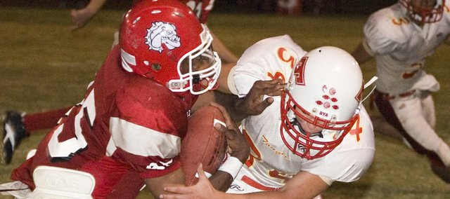 Tonganoxie High junior Dylan Fosdick goes in for a tackle against K.C. Wyandotte on Friday night at Kansas City, Kan. The Chieftains rallied from an 11-point third-quarter deficit for a 35-18 win.