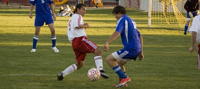 Joseph Parrino tries to control the ball against a defender during Tonganoxie High's 3-0 loss to Perry-Lecompton on Monday night at Chieftain Park.