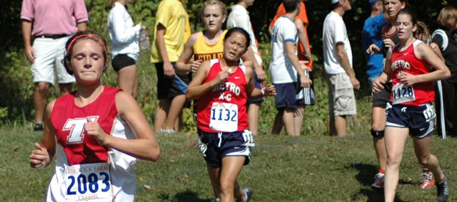 Andie Jeannin, Tonganoxie High senior, runs out in front of a pack of competitors on Saturday at the Rim Rock Farm Classic. Jeannin was the Chieftains' top runner in the Blue division, placing 25th.