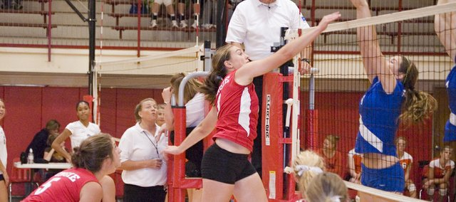 Danielle Miller puts away a kill for Tonganoxie High on Saturday during the Tonganoxie Invitational. Although the Chieftains lost their first two matches in pool play, they won their last three matches and the silver bracket at their home invite.