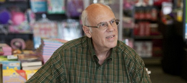 """Shawnee resident Kent Weatherby spent most of his career practicing law but now is acting on a once latent urge to write. He's promoting his debut novel, """"The Frenchman Ate the Fresh Bread First,"""" while his second work is at the publishing house and a third book is in the works. He's pictured here at a book-signing in Lawrence."""