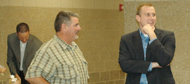 Eudora city administrator John Harrenstein, right, talks Sunday with Eudora Mayor Scott Hopson at the formal dedication of Eudora Elementary School. Harrenstein was hired Sept. 14 and will begin his duties Thursday.