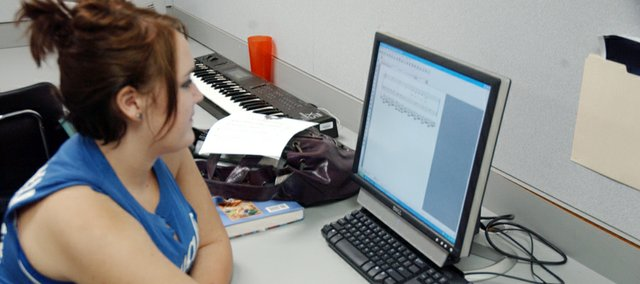 "De Soto High School senior Lacey West works on an arrangement of ""Jolly Old St. Nicholas"" using the computer program Finale for her music and technology class. She is one of 23 students enrolled in one of two sections of the class this semester."