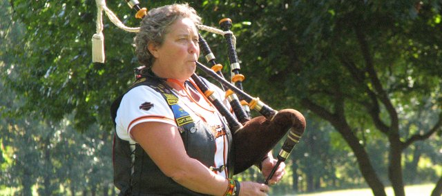 American Legion member Joan Moore plays the bagpipes at a ceremony honoring deceased veterans. Veterans, friends and family remembered three former members of the military on Sept. 24. Each month at Leavenworth National Cemetery, a service is conducted in which veterans pay honor to their newly fallen comrades.