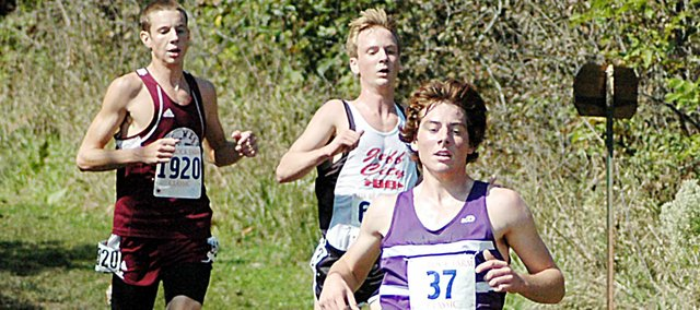 Baldwin High School junior Tony Weiss, front, runs down Mount Baldy during the middle of Saturday's Rim Rock Classic. Weiss placed 13th to medal for the Bulldogs.