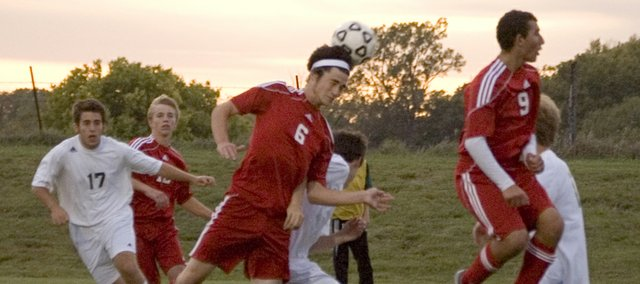 Preston Putthoff tries to head the ball in on a corner kick during Tonganoxie's 4-0 loss at Basehor-Linwood on Wednesday.