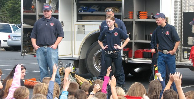 Fairmount Township Fire Department cadets answer a few questions Monday at the end of a presentation at Basehor Elementary School.