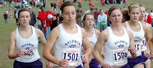 Baldwin High School's girls' cross country team begins Saturday's home meet. The Bulldogs won the meet as all eight Bulldogs finished in the top 21. Pictured, from left, are junior Heather Karlin, freshman Kaitlyn Barnes, sophomore Abi Hartzell, senior Julie Hill, senior Connor Twombly and sophomore Carol Whaley. Hidden behidn the other runners are freshman Sienna Durr and sophomore Elizabeth Sigvaldson.
