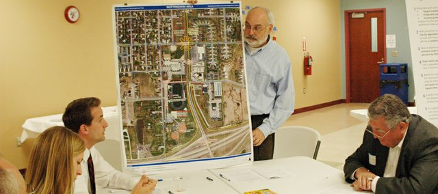 Scott Michie, of engineering and planning firm Bucher, WIllis and Ratlif, on Sept. 30 discusses  an aerial map of the Nottingham Community Learning Center and Laws Field area with Gary Pratt, Eudora Planning Commission Chairman Kurt von Achen, Eudora Fire Chief Randy Ates and Eudora City Council President Maria Nelson during an economic development workshop .