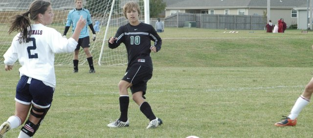 Duncan Henderson (10) passes the ball to an open teammate Saturday at Eudora. After a lacklaster perfromance in the first half, the seniors spoke up during halftime and the Wildcats went on to beat Eudora, 3-0.