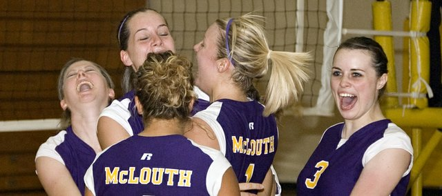 McLouth High volleyball players Taylor Rush, Cassidy Bristol, Jessie Troupe (4), Kylie Shufflebarger and Courtney Chilcoat are elated after scoring a clutch point late in a Senior Night victory over K.C. Christian on Tuesday night.