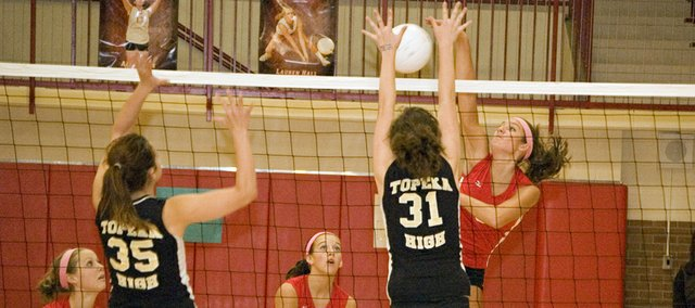 Tonganoxie High junior Molly O'Hagan rises up for a kill against Topeka on Thursday night. The Chieftains won the best-of-five match, 3-2.