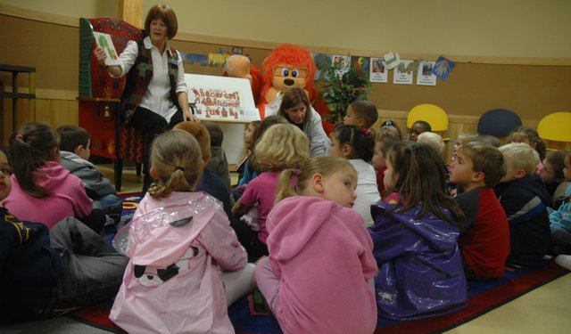 "Storytime coordinator Jeanne Dunbar reads ""The Very Hungry Caterpillar"" to Delaware Ridge preschoolers during Jumpstart's Read for the Record, Oct. 8."