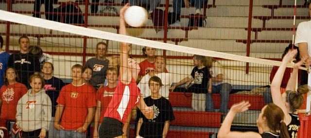 Molly O'Hagan puts away a kill for Tonganoxie High on Thursday night during the Chieftains' win over Topeka.