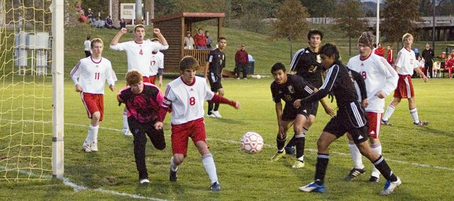 The Tonganoxie High soccer defense tries to clear the ball out of the box in the first half on Monday against Turner. The Chieftains (3-8-2) lost the match, 1-0.