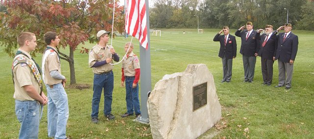 Thomas Miller and Cody Martin, left, look on at a ceremony for a flagpole Thomas installed with help from volunteers as part of an Eagle Scout project at Chieftain Park. Also pictured, from left, Zeke Kissinger, Garrett Martin and VFW members Larry Meadows, Dan Hopkins, Eddy Peel and Harold Denholm. Cody finished a similar project at Tonganoxie Nursing Center.